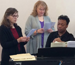 Choir with Music Director practicing