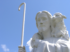 Statue of Jesus carrying a lamp and staff