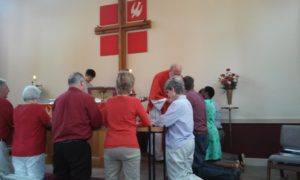 People taking communion photo